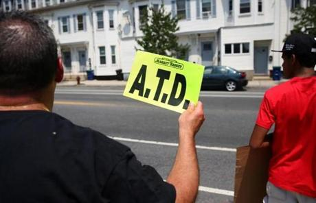 On Wednesday, protesters show their support for Arthur T. Demoulas outside of the Market Basket store in Somerville.