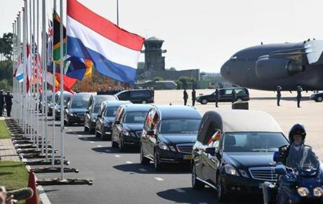 Hearses carried coffins containing unidentified bodies from the crash of Malaysia Airlines flight MH1 in Eindhoven, Netherlands.
