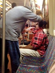 This tweeted cellphone photo of one man giving a shave to another while riding an MBTA Orange Line train went viral in Boston.