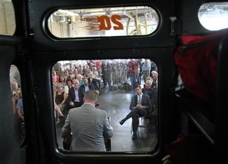 Boston Fire Department Deputy Chief Joseph E. Finn, framed through the window of Engine 20, was sworn in as city fire commissioner Monday.