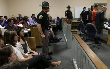 Abigail Hernandez (seated third from left) was in the courtroom for Kibby's arraignment.