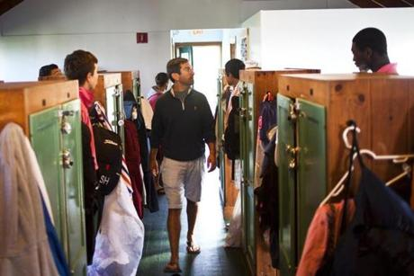 7/29/14 Nantucket Mass. Assistant camp director, Nick Riccardella, performs bunk-check in the cabin on Saturday, July 29, 2014 at Nantucket's Sankaty Head Caddie Camp. (Zack Wittman for the Boston Globe)