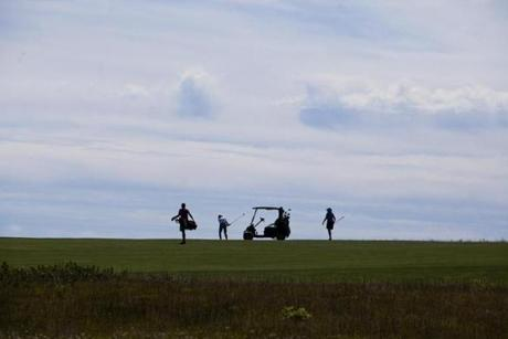 7/29/14 Nantucket Mass. Jack Eichen, left, caddies for members on Tuesday, July 29, 2014 at Nantucket's Sankaty Head Golf Club. (Zack Wittman for the Boston Globe)
