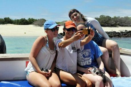 High school students (from left) Isabela Gettier, Elizabeth Thomas, Hannah Whitt Linsly, and Stephanie Kirby take a group selfie on a trip to the Galapagos this year.