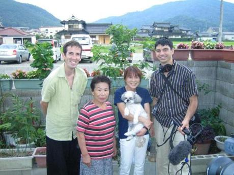 Filmmaker Perry Hallinan in Japan with Takashi Tanemori's surviving sister Satsuko, her daughter Yuri (holding Taro), and sound man Jeremy Biddle.