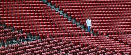 After a day full of trades by his team, Red Sox manager John Farrell walked through an empty Fenway Park.