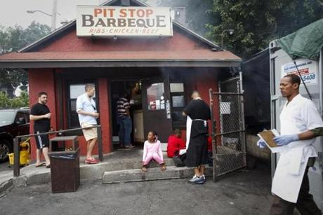 8/02/14 - Mattapan, MA - The Pit Stop BBQ in Mattapan is one of the Boston Globe Magazine's top 10 BBQ places in greater Boston for 2014. FOR MAGAZINE FEATURE ON BBQ - Item: 081714BarbecuePackage. Dina Rudick/Globe Staff