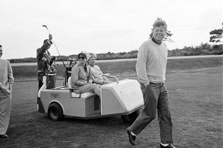 President Kennedy walked along the golf course after driving off from the tenth tee at the Country Club in Newport, R.I., in 1963.