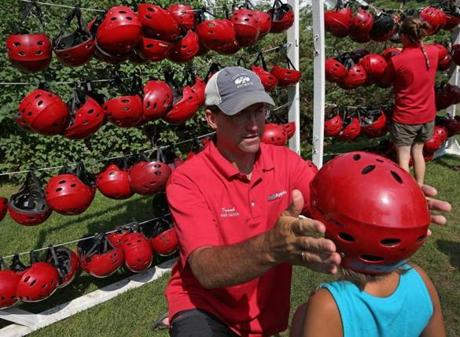 Frank Mooney of Crab Apple Whitewater adjusted the helmet of a young patron.