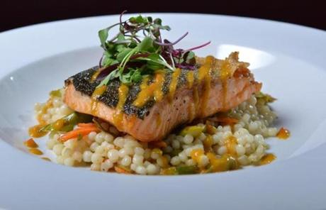 Pan-seared Arctic char entree served over couscous, shaved asaparagus and carrots with sweet pepper dressing at the Abbey in Cambridge. Josh Reynolds for The Boston Globe (Lifestyle, dining out, first)