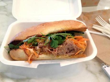 03travfood - Num Pang Sandwich Shop�s pulled pork sandwich with vegetables and cilantro. (Lisa Zwirn)