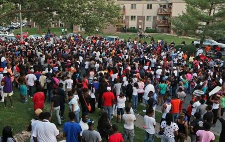 A large crowd gathered at the candlelight vigil Sunday evening in Ferguson, Mo.