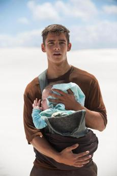 BRENTON THWAITES in the 2014 film THE GIVER, directed by Phillip Noyce. 15giver