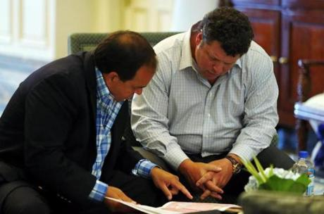 Boston, Massachusetts -- 08/13/2014-- Dunkin' Donuts franchise owners Mark Cafua (L) and Dan Fireman look over a map together at the Boston Harbor Hotel in Boston, Massachusetts August 13, 2014. Jessica Rinaldi/Globe Staff Topic: 092114Dunkindonuts Reporter: Neil Swidey