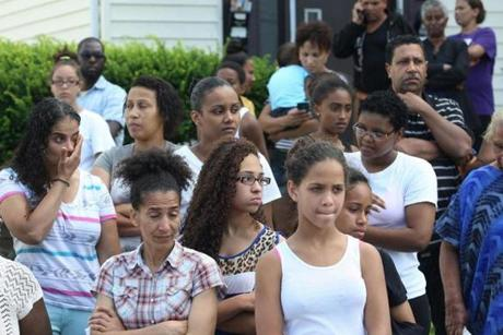 Dozens of people gathered late Thursday afternoon along a Brockton street where a youth was struck and killed by a scrap metal truck.