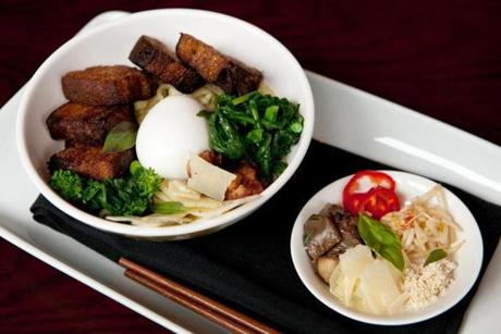 "Boston, MA - 08/15/14: Ramen Noodle ""Carbonara"" is served at Parla restaurant in Boston, Massachusetts. The dish consists of slow roasted karabuta pork belly, chilies, poached egg, broccoli rabe, guanciale dashi, and parmesan. (Kayana Szymczak for the Boston Globe)"