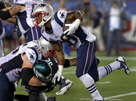 Foxborough, MA - 08/15/14 - (2nd quarter) New England Patriots running back James White (28) turns the corner looking for daylight on this carry in the second quarter. The New England Patriots take on the Philadelphia Eagles in a pre-season exhibition game at Gillette Stadium. - (Barry Chin/Globe Staff), Section: Sports, Reporter: Shalise Manza-Young, Topic: 16Patriots-Eagles, LOID: 7.4.1027210871.