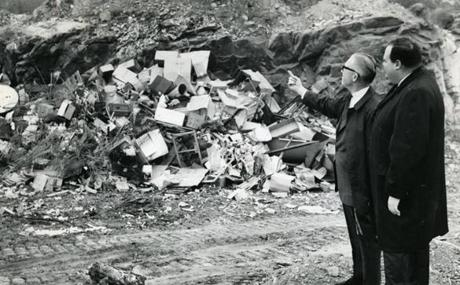 April 22 1966 / fromthearchive / Globe Staff photo by Edward F. Carr / Quincy Public Works Commissioner Charles Herbert showed Quincy Mayor James R. McIntyre an old quarry where refuse will be covered with sanitary landfill.