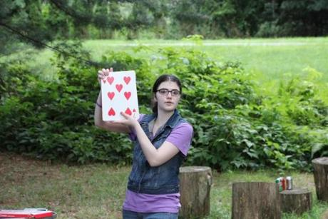 Kira Schwartz does a trick at the Society of Young Magicians barbecue.