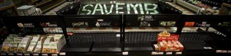 "8/22/14 Somerville, Mass. ""ATD"" and ""SAVE MB"" are spelled out in empty packaging at the Somerville Market Basket store on Friday afternoon, August 22, 2014 in Somerville. (Zack Wittman for the Boston Globe)"