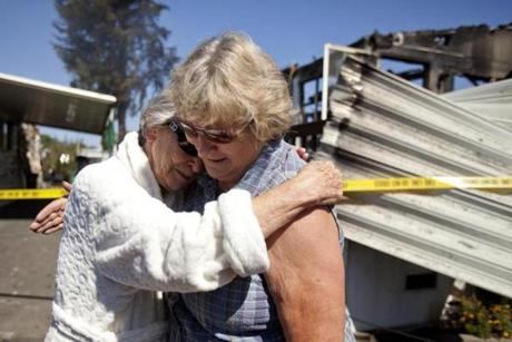 Nola Rawlins,  83, hugged neighbor Jean Crawford after surveying her residence, one of four mobile homes that were destroyed by a fire in Napa.