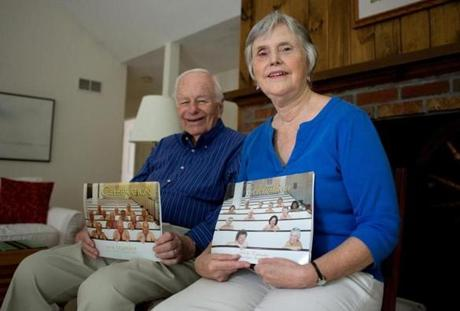 Hugo Hollerorth (left) and his girlfriend, Diane Engel, hold calendars they posed nearly nude for as a fundraiser for their church.