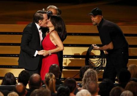 Bryan Cranston kissed Julia-Louis Dreyfus as she took the stage to accept her Emmy Award.