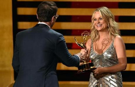 Amy Poehler handed Ty Burrell his Emmy Award.