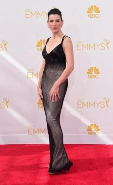 Julianna Margulies arrives on the red carpet for the 66th Emmy Awards, August 25, 2014 at Nokia Theatre in Los Angeles, California. AFP PHOTO / Frederic J. BrownFREDERIC J BROWN/AFP/Getty Images