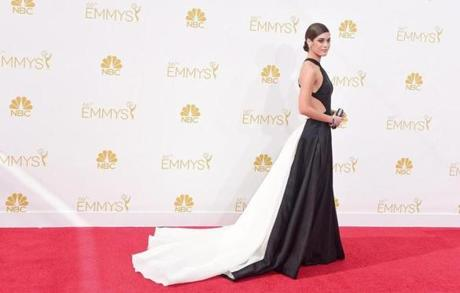 Lizzy Caplan arrived on the red carpet. She was nominated for lead actress, drama for