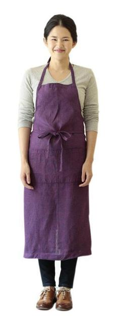 A Shop Fog Linen apron, tied in front.