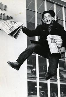 April 8 1966 / fromthearchive / Globe Staff photo by Charles Dixon / Edward McCarthy, 8, of Jamaica Plain jumped with joy after picking up some of the first Boston Globes off the press as the Boston newspaper strike ended. The strike, which began March 6th resulted in the longest newspaper blackout in Boston history. The cost was estimated at more than 30 million dollars.