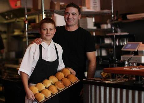 Medford, MA., 08/27/14, Chef Nick Dowling with his son Aidan, 11, who bakes the bread for the restaurant. Snappy Pattys is profiled for Cheap Eats. Suzanne Kreiter/Globe staff (The Boston Globe.