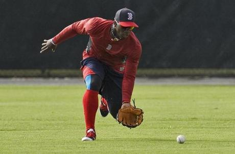 SPECIAL FOR THE BOSTON GLOBE, ATTN: PHOTO DESK--Cuban defector Rusney Castillo, the Boston Red SoxÕ new $72.5 million outfielder, chases a ground ball during a workout Thursday, Aug. 28, 2014, at the Red Sox training facility in Fort Myers, Fla. (Steve Nesius/Associated Press for The Boston Globe)