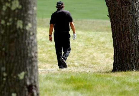 Phil Mickelson walks up the sixth fairway.