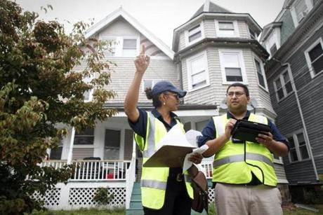 Dozens of people moved in and out of apartments in a part of Allston known for its student population during Labor Day weekend as leases typically begin on Sept. 1. Pictured: Housing inspectors Iris Jones and Marcio Fonseca Jr.