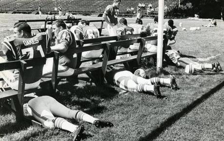 July 26 1968 / fromthearchive / Globe Staff photo by Frank O'Brien / Getting out of the hot sun during training camp in a very unsophisticated way were l-r on the ground, Charlie Long, Houston Antwine and Daryl Johnson.