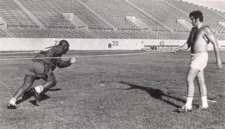 July 8 1969 / fromthearchive / Globe Staff photo by Daniel Wolf / Jim Lee Hunt on the left and Jim Boudreau appeared to the only two at practice doing this odd workout drill during Patriots training camp.