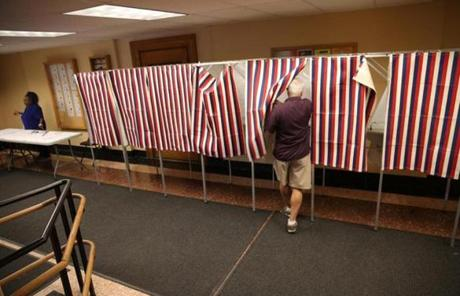 A lone voter entered the booth in the basement of Cambridge City Hall.