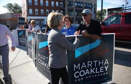 Coakley shook hands with Bill Young after voting.
