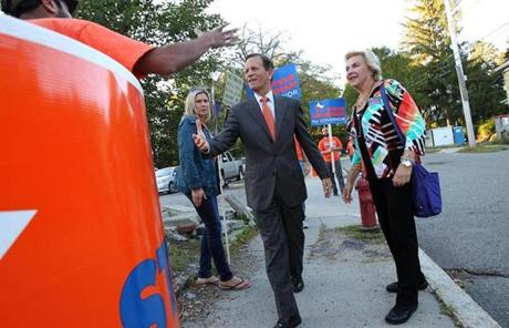 The Democratic gubernatorial candidate shook hands with a supporter outside the school.