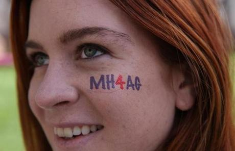 Allie Owen, of Cambridge, had a temporary tattoo under her eye supporting AG hopeful Maura Healey.