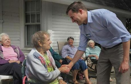 Seth Moulton visited residents at the Girdler House in Beverly.