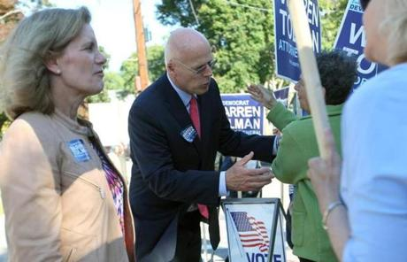 Democratic AG candidate Warren Tolman greeted sign holders in Watertown.