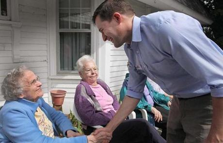 Democratic congressional candidate Seth Moulton greeted Marjorie Needham during a campaign stop at Girdler House in Beverly.