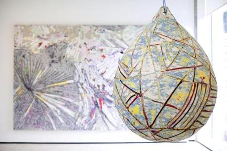 "9/13/14 - Waltham, MA - Brandeis University - Rose Art Museum - The painting at left is ""No Time to Expand The Sea."" Collage/Mixed Media. The piece on the right is from ""Sea Pig"" - 6 Buoys, 43"" x 56"" each. Collage/Mixed Media. For Sebastian Smee review of ""Mark Bradford: Sea Monsters,"" a show of new paintings and sculptures by widely admired artist and MacArthur Award winner Mark Bradford, influenced by 16th- and 17th-century decorated maps of the sea, at the Rose Art Museum. Story by Sebastian Smee/Globe Staff. Dina Rudick/Globe Staff."