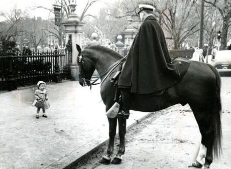 April 6 1958 / fromthearchive / Globe Staff photo by Harry T. Holbrook / Little Elaine Martin, in her Easter finery, stopped to look at Officer Benjamin Donahue aboard his horse, Justin's Son near the Boston Public Garden
