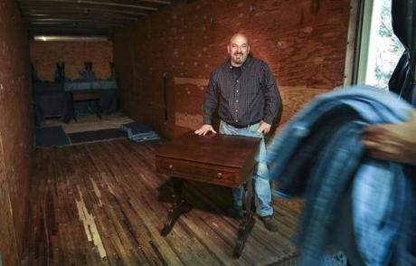 Northwood, NH - Monday, Sept. 22, 2014: As desks are being loaded into the back of a truck, Douglas Dimes, 5th generation master craftsman, and, president of D.R.Dimes & Company, Ltd stands with one of the hand crafted replica senate desks his company made for use in the new Ted Kennedy Institute on the US Senate in Boston. CREDIT: Cheryl Senter for The Boston Globe