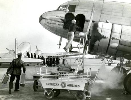 February 19 1940 / fromthearchive / Boston Globe Staff photo by Paul J. Maguire / A porter unloaded baggage from an incoming American Airlines flight. Passenger traffic over routes of American Airlines had set a new record for air traffic in January, when the flagships transported 45,939 passengers an increase of 83.5 percent over January 1939.