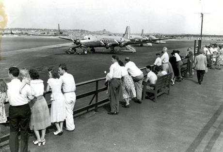 August 25 1948 / fromthearchive / Boston Globe photo by Gil Friedberg / A broad view of the entire airport was gained from the observation promenade atop the Administration Building. The control tower can be seen in mid-field. Here, for just the cost of a dime, people could watch the arrival and departure of aircraft.